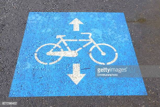 cycle track markings in blue and white along the promenade in izmir. - emreturanphoto stock pictures, royalty-free photos & images