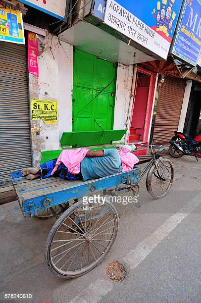A cyclecart puller asleep at Godowlia Chowk on April 26 2016 in Varanasi India Summers in India are not for the fainthearted During the afternoons...