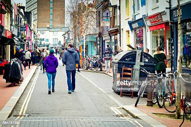 Cycles, shoppers and second hand clothes stall