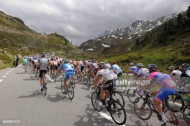 75th Tour de Suisse / Stage 7 Peleton Peloton / FLUELAPASS 2383m / Mountains Montagnes Bergen / Landscape Paysage Landschap / Illustration...