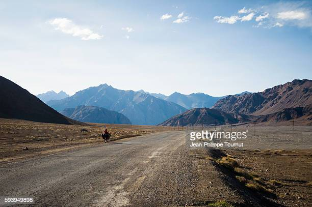 Cycling around the world on a recumbent bike, crossing the Pamirs mountains of Tajikistan, Central Asia