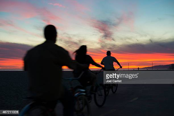 cycling at sunset on venice beach bikeway - image title stock pictures, royalty-free photos & images