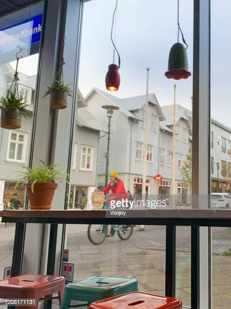cycling at the downtown, reykjavik, iceland - vsojoy stock pictures, royalty-free photos & images