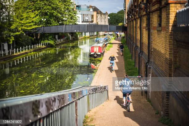 Cycling by the Canal at Ladbroke Grove in the Royal Borough of Kensington and Chelsea, London, England, United Kingdom.
