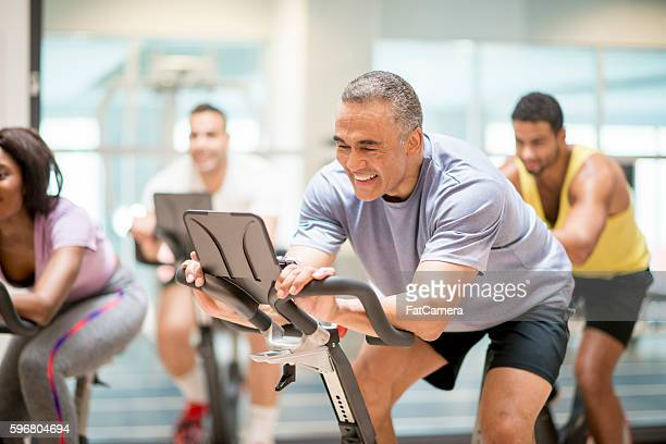 cycling class at the gym - gym stock pictures, royalty-free photos & images