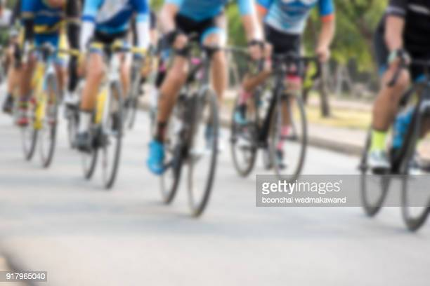 Cycling competition,cyclist athletes riding a race at high speed  /  Blur focus