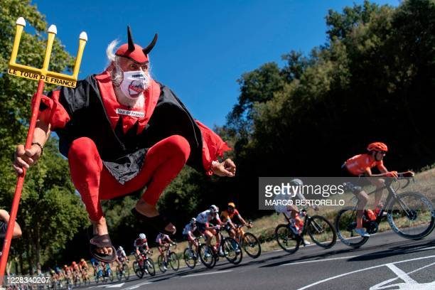 Cycling fan Didi Senft, aka El Diablo, cheers for the riders during the 7th stage of the 107th edition of the Tour de France cycling race, 168 km...