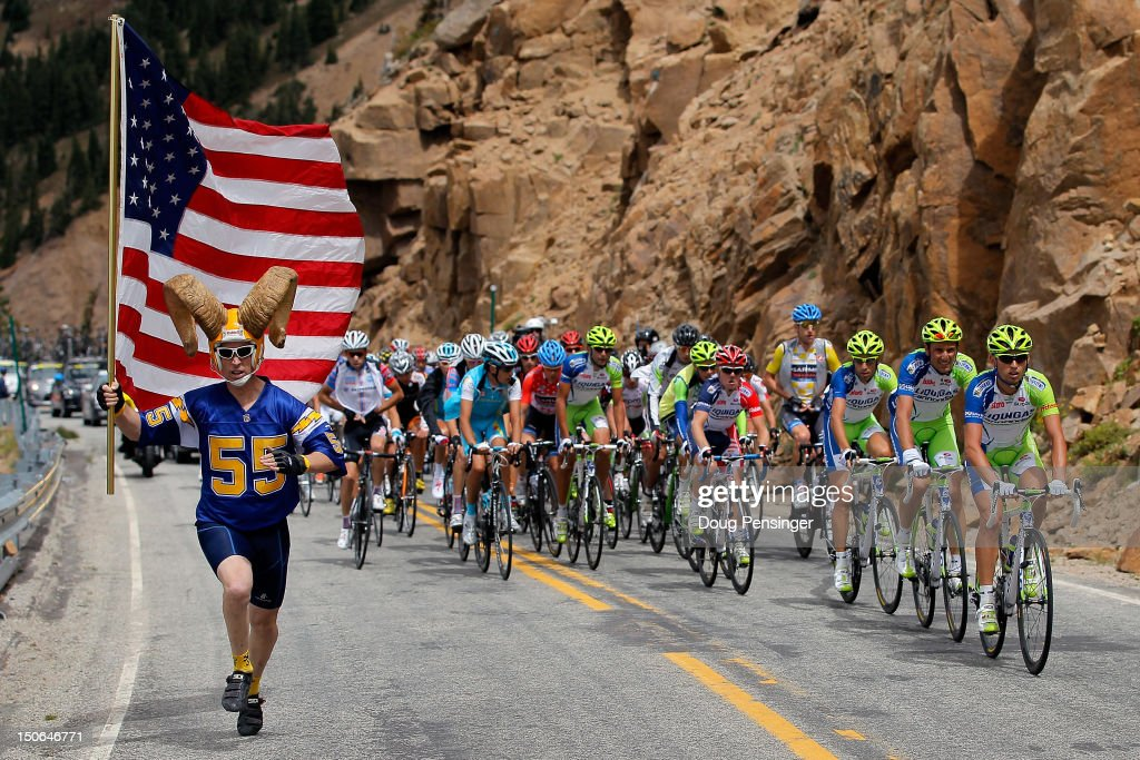 Cycling fan Dory Holte chases as the peloton as Liquigas-Cannondale rides at the front on the climb of Indpendence Pass during stage four of the USA Pro Challenge from Aspen to Beaver Creek on August 23, 2012 in Pitkin County, Colorado.