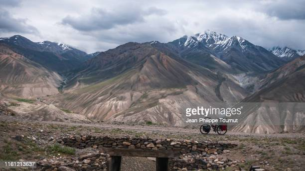 cycling from the afghan border to the pamir plateau across kargush pass, tajikistan, central asia - badakhshan stock pictures, royalty-free photos & images