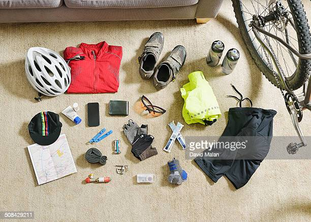 cycling gear spread out on a lounge floor - equipamento esportivo - fotografias e filmes do acervo