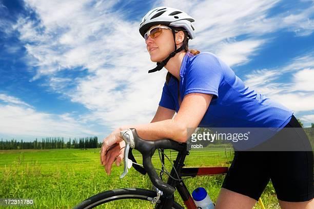 サイクリングの少女 - ロードバイク ストックフォトと画像