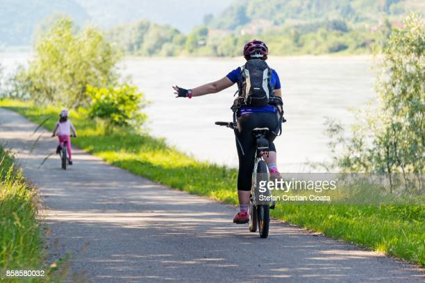 cycling hand signs - danube river stock pictures, royalty-free photos & images