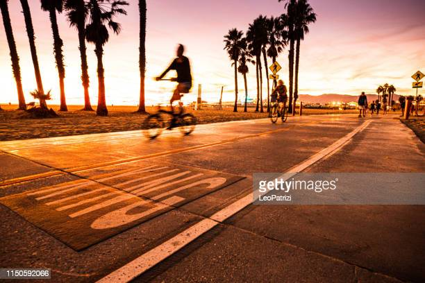 cycling in santa monica boardwalk - los angeles - usa - la waterfront stock pictures, royalty-free photos & images