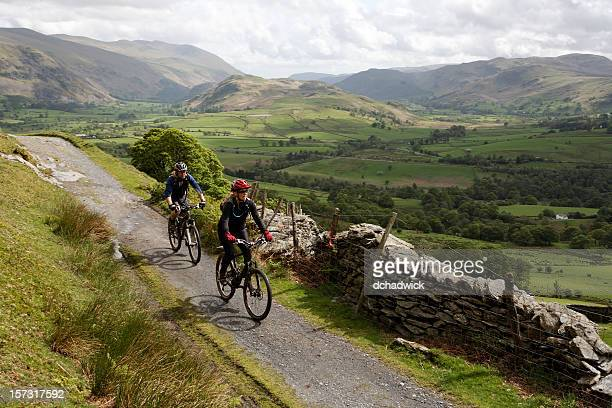 cycling in the lake district - cumbria stock pictures, royalty-free photos & images