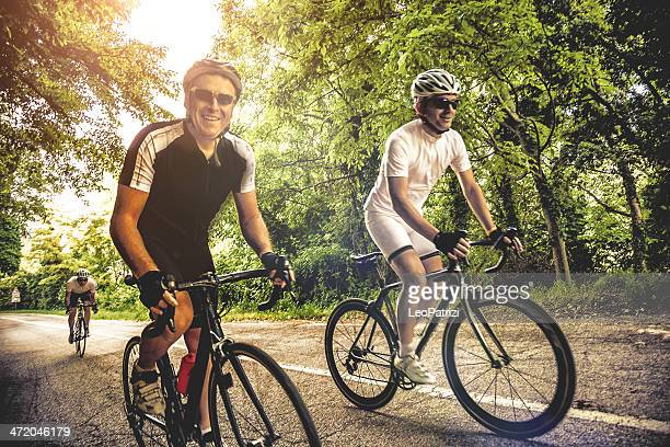 cycling on a country road - racing bicycle stock pictures, royalty-free photos & images