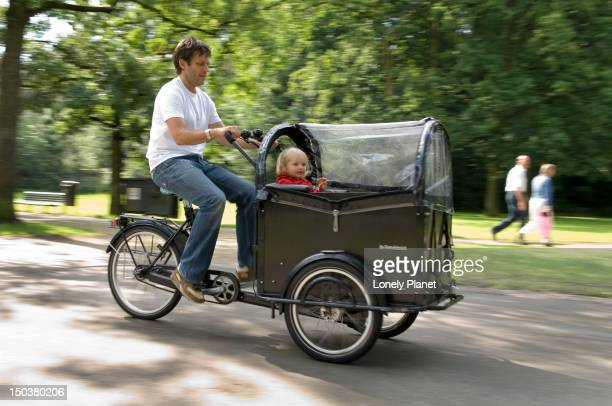 Cycling on cargo bike in Vondelpark.