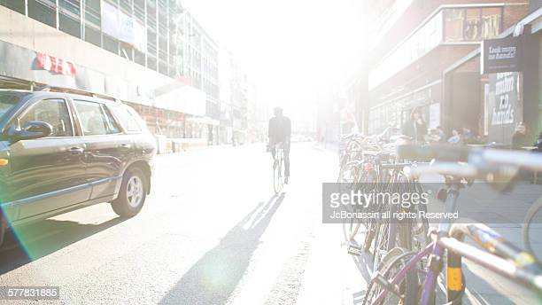 cycling on london uk - jcbonassin stock pictures, royalty-free photos & images