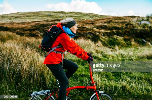 cycling on north uist, scotland - bicycle stock pictures, royalty-free photos & images