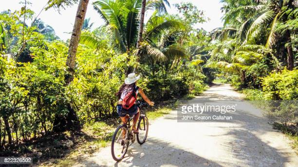 cycling on siargao island - beautiful filipino women stock photos and pictures