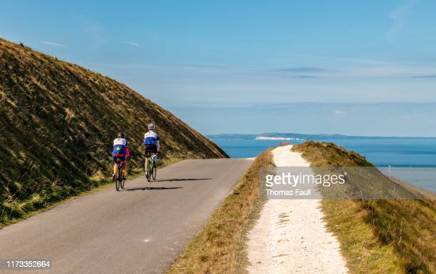 cycling on the isle of wight - isle of wight stock pictures, royalty-free photos & images