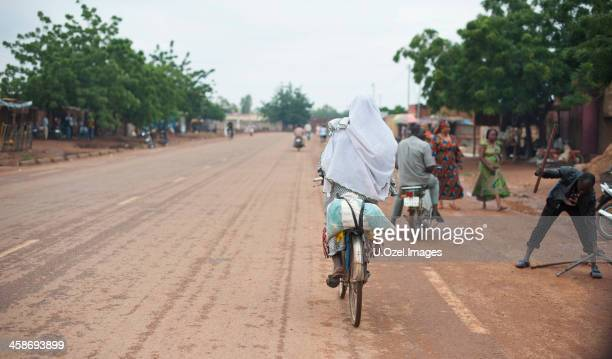 cycling on the road. - ouagadougou stock pictures, royalty-free photos & images