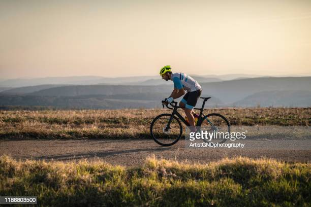cycling outdoors. - professional sportsperson stock pictures, royalty-free photos & images