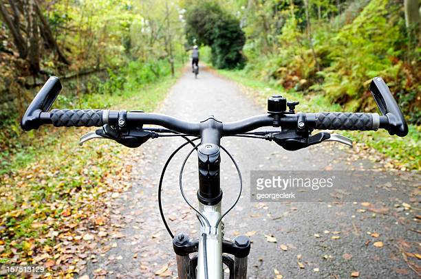 cycling path in autumn - handlebar stock photos and pictures