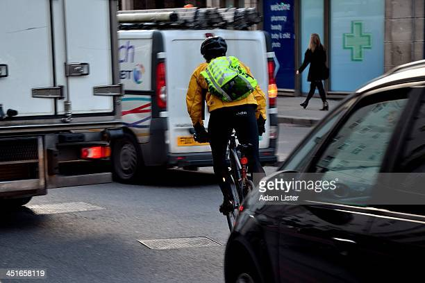 A cyclist weaves his bike between Rush Hour traffic vans and lorries at speed in Central London the discussions about cycling safety continues...
