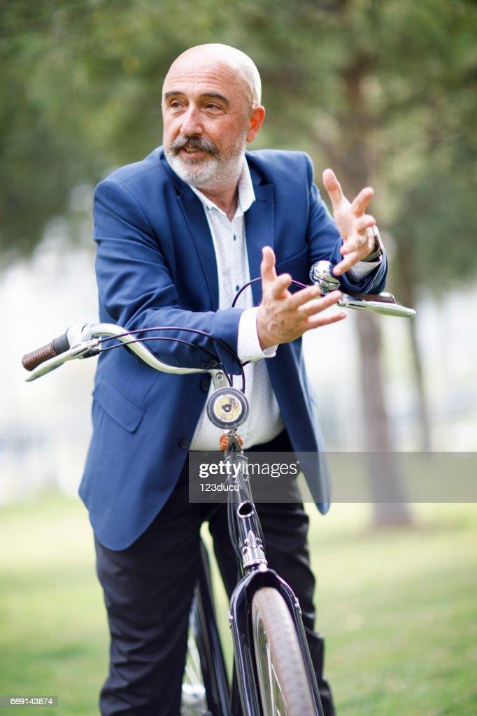 Cycling Senior Businessman : Stock Photo