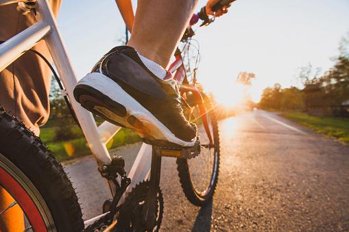 cycling sport, feet on pedal of bike 874244168