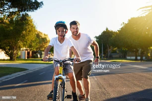 Cycling through his block