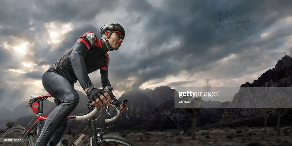 Cycling Through Mountains : Stock Photo