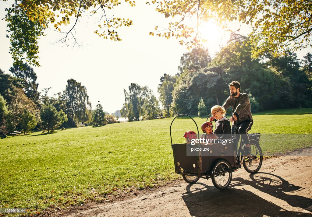 Cycling through the park : Stock Photo