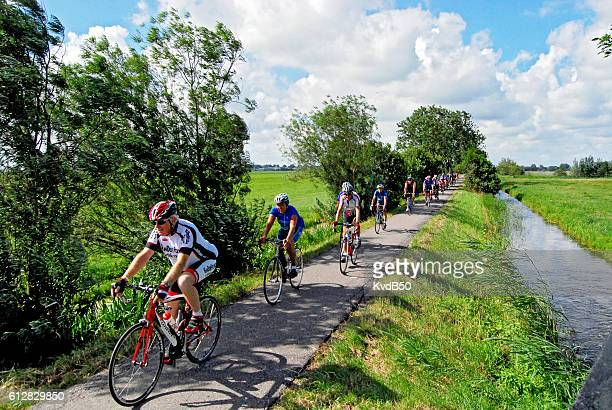 cycling through the polder - racing bicycle stock pictures, royalty-free photos & images