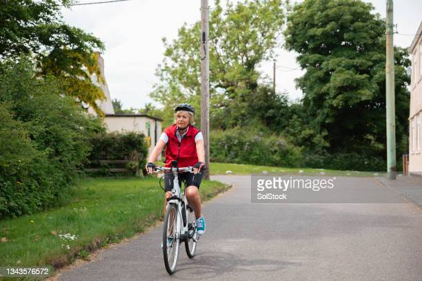 cycling through town - morpeth stock pictures, royalty-free photos & images