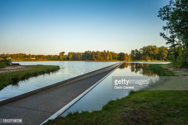 cycling through water - capital region stock pictures, royalty-free photos & images