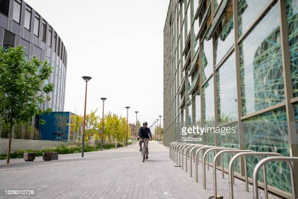 cycling to work in the morning - green blazer stock pictures, royalty-free photos & images
