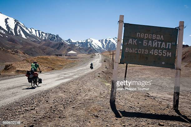 Cycling up to Ak-Baital pass (4655m)in the Pamir mountains of Tajikistan (Central Asia) during a world tour by bicycle