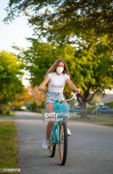 cycling using protective face mask - avoidance stock pictures, royalty-free photos & images