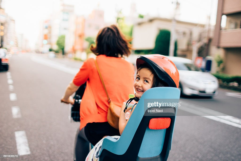 Cycling with a toddler girl in urban city, Tokyo : Stock Photo