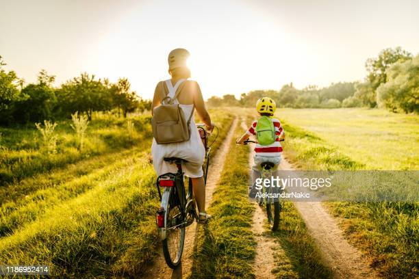 cycling with my mom - family with one child stock pictures, royalty-free photos & images