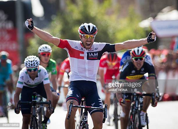 IAM Cycling's Belgian cyclist Jonas Van Genechten celebrates as he crosses the finish line to win the 7th stage of the 71st edition of 'La Vuelta'...
