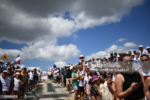 Cyclism enthusiasts wait for riders in the Mur d'AurecsurLoire during the ninth stage of the 106th edition of the Tour de France cycling race between...