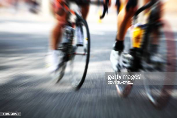 cyclist action blur - road race stock pictures, royalty-free photos & images