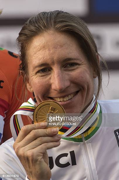 US cyclist Amber Neben celebrates on the podium after winning the gold medal in the women's elite individual time trial event as part of the 2016 UCI...