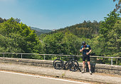 cyclist bike resting river