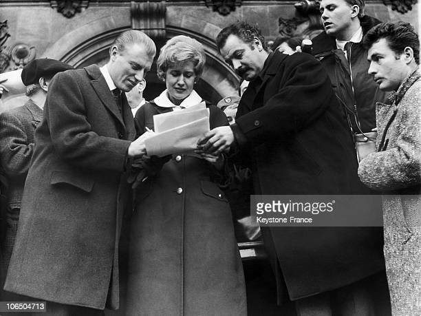 Cyclist Andre Darrigade And Singer Georges Brassens Signing A Demand By Singer Georgie Viennet To Get Official Forgiveness For The American Sentenced...