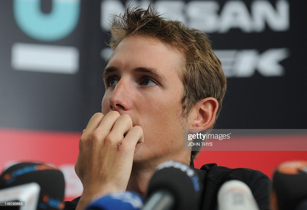 Cyclist Andy Schleck of Luxembourg gestures during a press conference in Strassen on June 13, 2012. Yellow jersey contender Schleck has pulled out of this year's Tour de France due to injuries suffered in last week's Criterium du Dauphine race.
