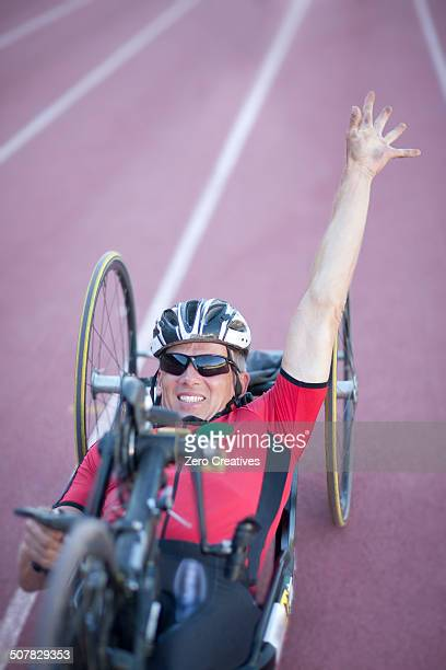 Cyclist at finishing line in para-athletic competition