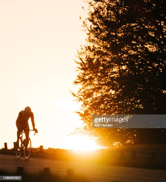 cyclist at sunrise - london park - dawn stock pictures, royalty-free photos & images